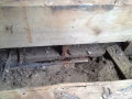 Wood foundation sitting on dirt